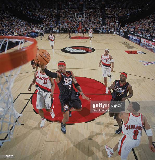 Guard Allen Iverson of the Philadelphia 76ers shoots a layup during the NBA game against the Portland Trail Blazers at the Rose Garden in Portland...