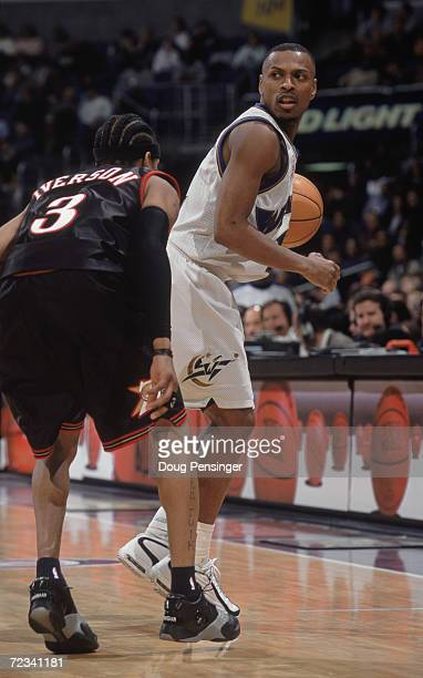 Guard Chris Whitney of the Washington Wizards dribbles the ball as point guard Allen Iverson of the Philadelphia 76ers plays defense during the NBA...