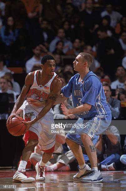 Guard Juan Dixon of the Maryland Terrapins looks to play the ball against guard Brian Morrison of the North Carolina Tarheels during the ACC game at...