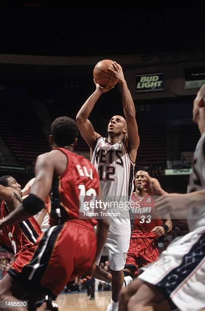 Guard Lucious Harris of the New Jersey Nets shoots a jump shot during the NBA game against the Miami Heat at Continental Airlines Arena in East...