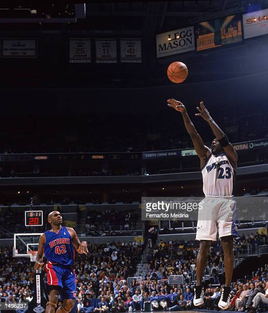 Guard Michael Jordan of the Washington Wizards shoots a jump shot during the NBA game against the Detroit Pistons at the MCI Center in Washington DC...