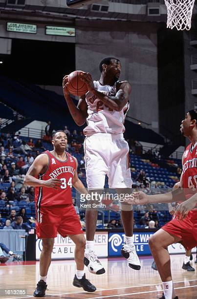 Guard Nate Johnson of the Columbus Riverdragons rebounds the ball during the NBDL game at against the Fayetteville Patriots at the Crown Coliseum in...