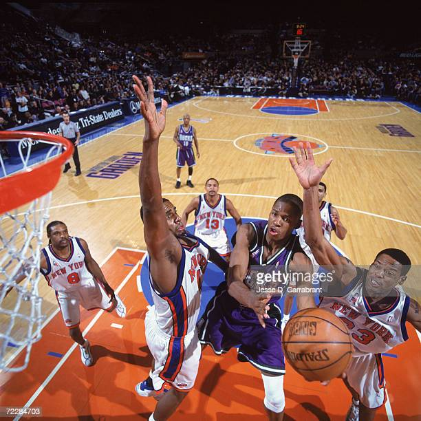 Guard Ray Allen of the Milwaukee Bucks shoots the ball as two New York Knicks forward Kurt Thomas and center Marcus Camby attempt to block during the...