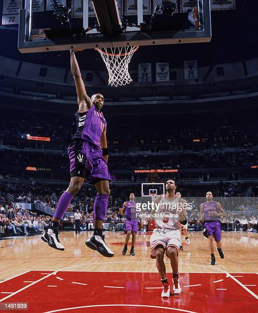 Guard Vince Carter of the Toronto Raptors dunks the ball during the NBA game against the Chicago Bulls at the United Center in Chicago, Illinois. The...