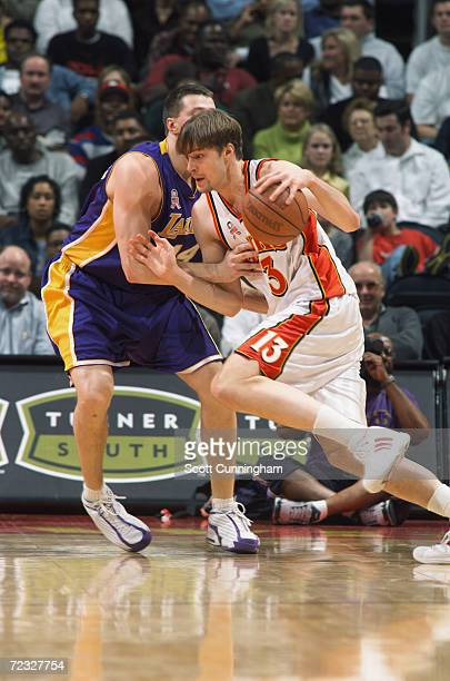 Hanno Motola of the Atlanta Hawks drives against Slava Medvedenko of the Los Angeles Lakers during their game at Philips Arena in Atlanta Georgia...