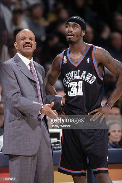 Head coach John Lucas of the Cleveland Cavaliers talks to guard Ricky Davis during the NBA game against the Golden State Warriors at the Arena in...