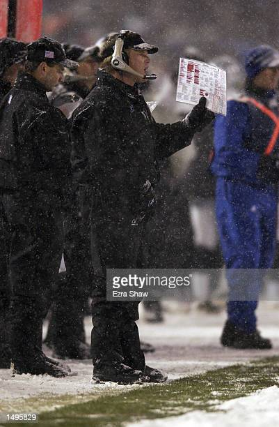Head coach Jon Gruden of the Oakland Raiders looks on during the AFC playoff game against the New England Patriots at Foxboro Stadium in Foxboro...