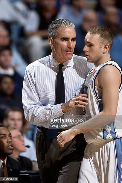 Head coach Matt Dougherty of the North Carolina Tar Heels talks to Brian Morrison during the ACC Conference basketball game against the Virginia...