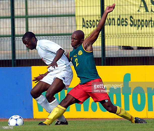 Jackson Tchato of Cameroon challenges Kouadji Dogbe of Togo during the African Cup of Nations match between Cameroon and Togo played at the Stade de...