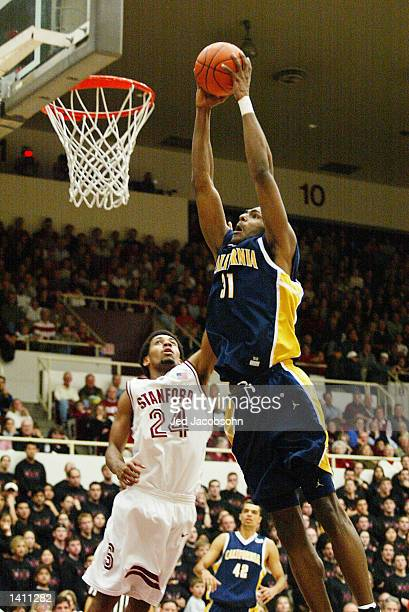 Jamal Sampson of the University of California shoots over Julis Barnes of Stanford during a Pac10 game at Maples Pavillion at Stanford University in...