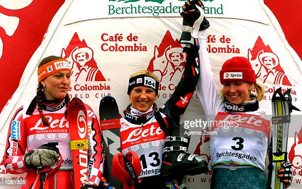Janica Kostelic of Croatia, Marlies Oester of Switzerland and Kristina Koznick of the USA celebrate on the podium following the women's slalom at the...