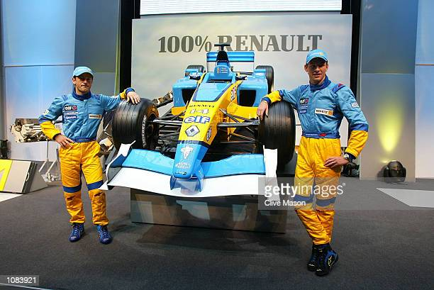 Jarno Trulli and Jenson Button pose during the launch of the new Renault F1 R202 Formula One car at the Technocentre in Paris France DIGITAL IMAGE...