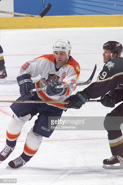 Jason Wiemer of the Florida Panthers skates against Mike Modano of the Dallas Stars during the game at the National Car Rental Center in Miami...