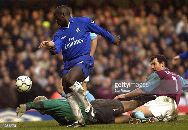 Jimmy Floyd Hasselbaink of Chelsea rounds David James of West Ham to score the third goal during the FA Barclaycard Premiership match between Chelsea...