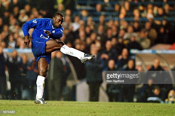 Jimmy Floyd Hasselbaink of Chelsea scores the 2nd goal during the Worthington Cup Semi Final 1st Leg between Chelsea and Tottenham Hotspur at...
