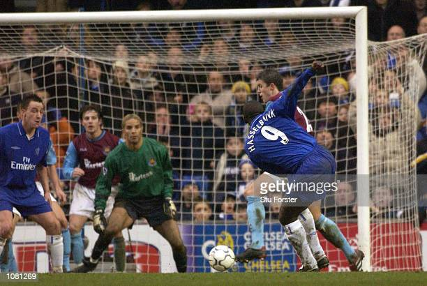 Jimmy Floyd Hasselbaink of Chelsea shoots to score the opening goal in injury time of the first half during the FA Barclaycard Premiership match...