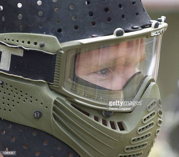 Justin Leppitsch of the Brisbane Lions takes aim during a game of Paintball against fellow Lions players The Brisbane Lions players are using the...