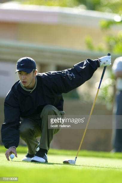 Justin Timberlake of N'sYNC lines up a putt during the opening round of the Bob Hope Chrysler Classic at Indian Wells Country Club in La Quinta...