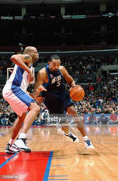 Juwan Howard of the Dallas Mavericks drives around Sean Rooks of the Los Angeles Clippers during their game at Staples Center in Los Angeles CA The...