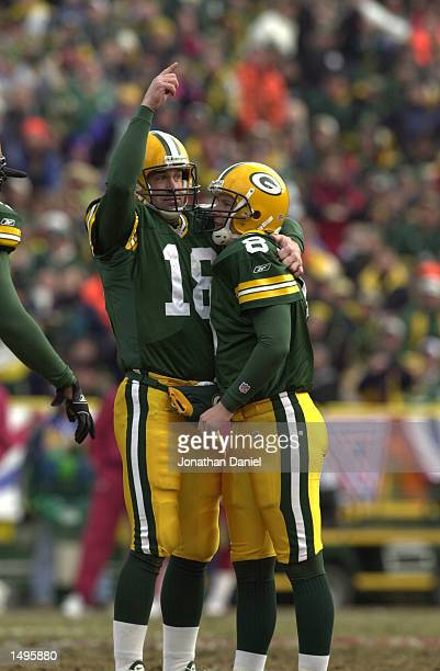 Kicker Ryan Longwell of the Green Bay Packers and teammate Doug Pederson celebrate during the NFC wildcard game against the San Francisco 49ers at...