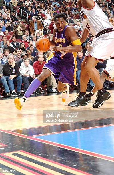 Kobe Bryant of the Los Angeles Lakers drives the baseline against Derrick Coleman of the Philadelphia 76ers at the First Union Center, Philadelphia,...