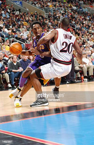 Kobe Bryant of the Los Angeles Lakers leans in on Eric Snow of the Philadelphia 76ers at the First Union Center Philadelphia Pennsylvania DIGITAL...