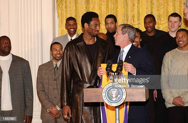 Kobe Bryant of the Los Angeles Lakers presents President W George Bush with a personalized Lakers jersey during the Lakers visit to the White House...