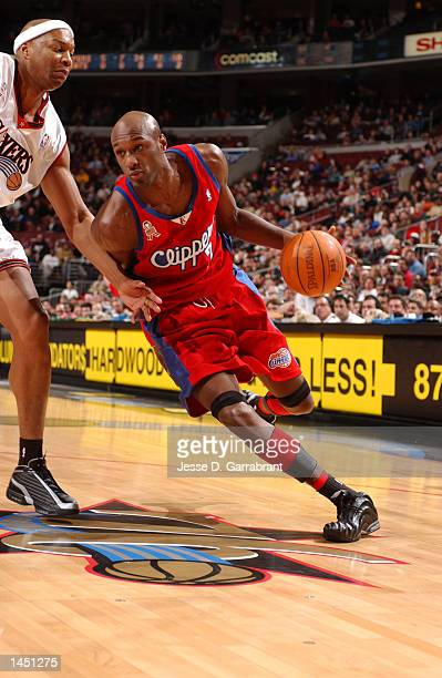 Lamar Odom of the Los Angeles Clippers drives on Derrick Coleman of the Philadelphia 76ers at the First Union Center, Philadelphia, Pennsylvania....