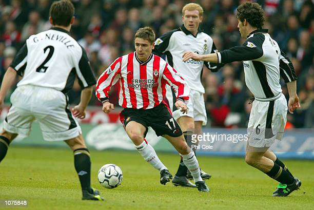 Marain Pahars of Southampton takes on Gary Neville and Laurent Blanc of Manchester United during the FA Barclaycard Premiership match between...