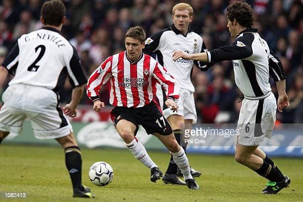 Marian Pahars of Southampton is closely watched by Gary Neville and Laurent Blanc of Manchester United during the FA Barclaycard Premiership match...