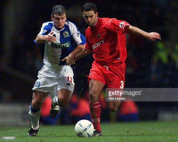 Mark Hughes of Blackburn Rovers goes shoulder to shoulder with Chris Barker of Barnsley during the AXA sponsored FA Cup third round replay match...