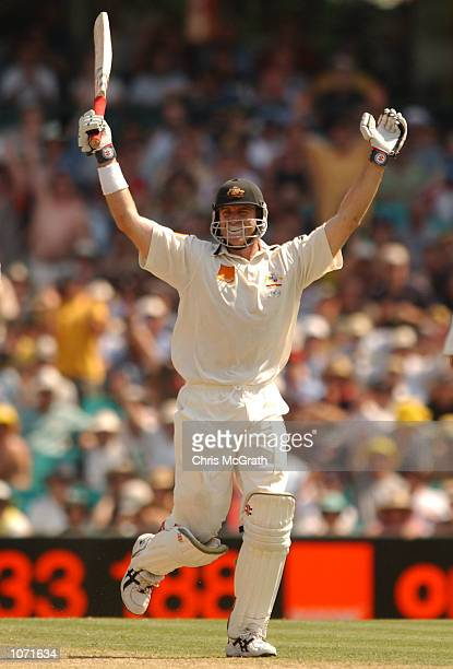 Matthew Hayden of Australia celebrates after he scored his century during the first day's play in the third test match between Australia and South...