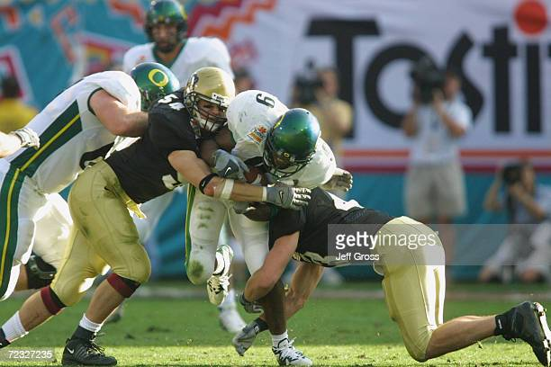 Maurice Morris of Oregon is crushed between Joey Johnson and Sean Tuffs of Colorado during the game at the Fiesta Bowl at Sun Devil Stadium in Tempe...
