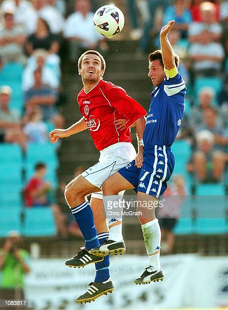 Michael Cunico of United contests a header with Steve Panopoulos of South Melbourne during the NSL match between Sydney United and South Melbourne...