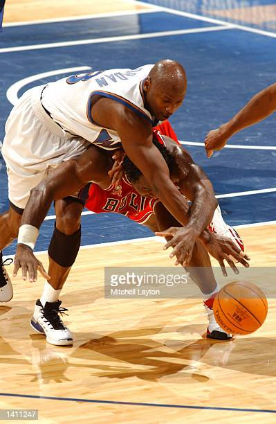 a6f2cc088e Michael Jordan of the Washington Wizards goes over Charles Oakley of the  Chicago Bulls to fight