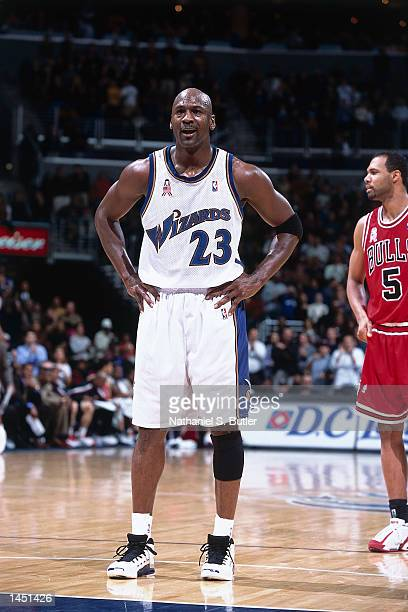 Michael Jordan of the Washington Wizards waits after scoring his 30000 point against the Chicago Bulls during a NBA game at the MCI Center in...