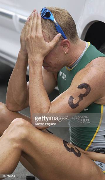Miles Stewart of Australia breaks down in tears after the finish of the race after hearing the news that his close friend and fellow triathlete Luke...