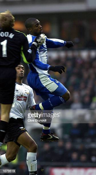 Nathan Ellington of Bristol out jumps Mark Poom of Derby to score during the match between Derby County and Bristol Rovers in the AXA FA Cup third...