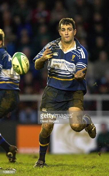 Nathan Spooner of Leinster passes the ball on during the Heineken Cup quarterfinal match against Leicester Tigers played at Welford Road in Leicester...