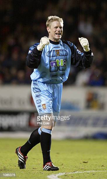 Peter Schmeichel of Aston Villa celebrates a goal during the FA Barclaycard Premiership match against Charlton Athletic played at The Valley in...