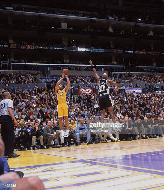 Point guard Derek Fisher of the Los Angeles Lakers shoots over point guard Terry Porter of the San Antonio Spurs during the NBA game at the Staples...