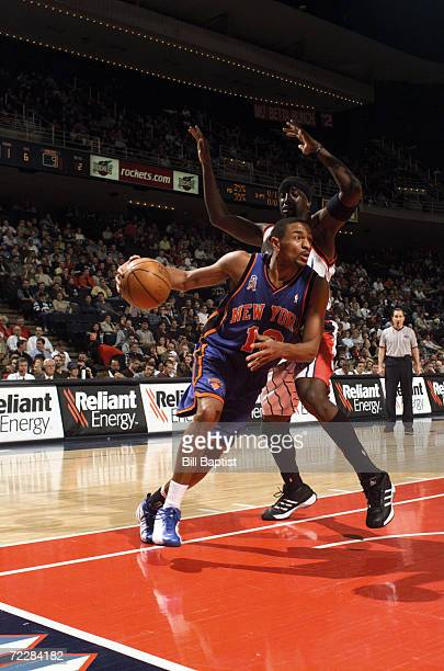 Point guard Mark Jackson of the New York Knicks drives past guard Walt Williams of the Houston Rockets during the NBA game at the Compaq Center in...