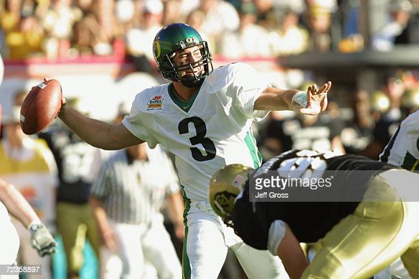 Quarterback Joey Harrington of Oregon drops back to throw a pass during the game against Colorado at the Fiesta Bowl at Sun Devil Stadium in Tempe...