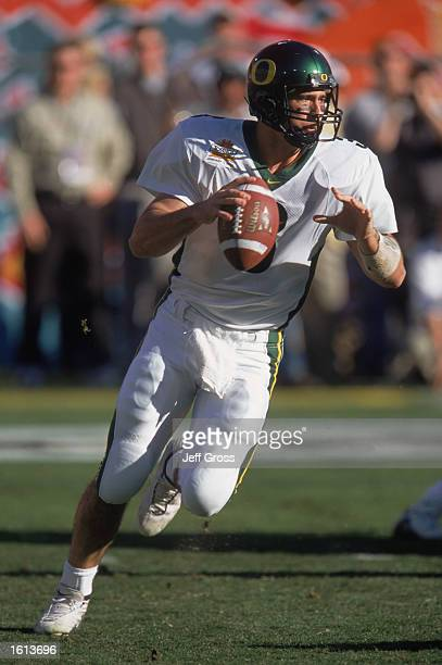 Quarterback Joey Harrington of the Oregon Ducks looks to pass the ball against the Colorado Buffaloes during the Tostitos Fiesta Bowl at Sun Devil...