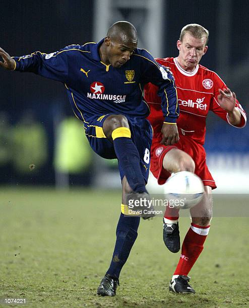 Robbie Mustoe of Middlesbrough comes into challenge Damien Francis of Wimbledon during the AXA sponsored FA Cup Third Round match between Wimbledon...