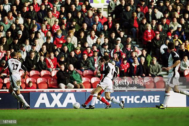 Robbie Stockdale of Middlesbrough brings the ball forward as he is closed down by Ryan Giggs of Manchester United during the AXA sponsored FA Cup...