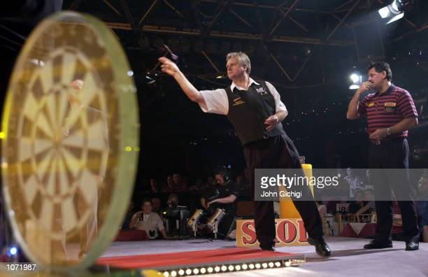 Rod Harrington in action against Dennis Priestley in their second round match at the PDC Skol World Darts Championships at The Circus Tavern Purfleet...