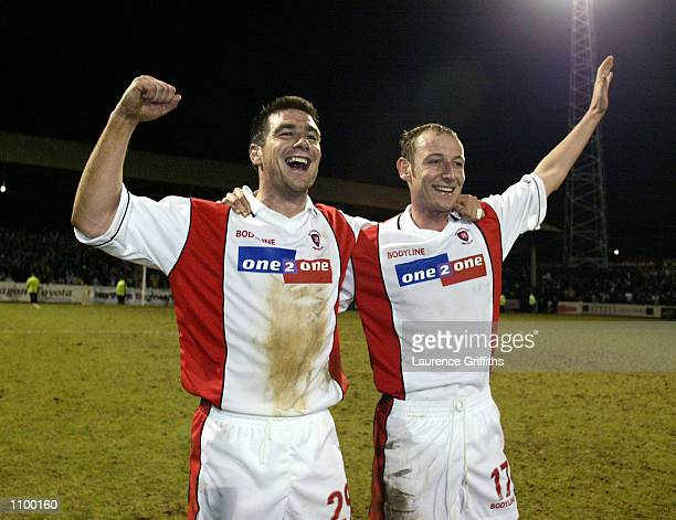 Rotherham United goalscorers Richie Barker and John Mullin celebrate victory after the AXA sponsored FA Cup third round match against Southampton...