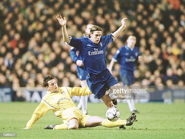 Sam Dalla Bona of Chelsea is tackled by Ian Harte of Leeds during the FA Barclaycard Premiership match between Chelsea and Leeds United at Stamford...