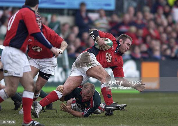 Scott Quinnell of Llanelli tackled by Neil Back of Leicester during the Heineken Cup Pool 1 game between Llanelli and Leicester Tigers at Stradey...